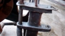 Broken roller hook arm close up
